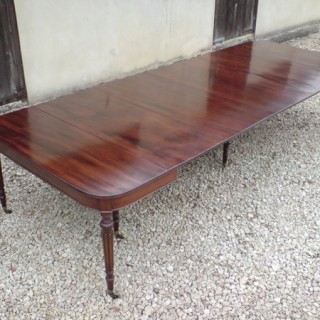 Regency Mahogany Concertina Action Dining Table manner of Wilkinson of Moorfields (c. 1810	England)