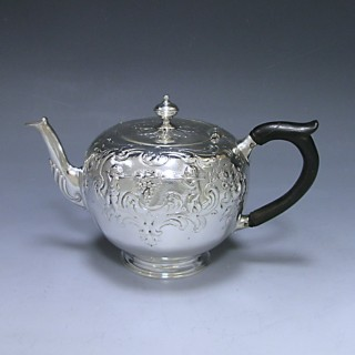 ANTIQUE SILVER VICTORIAN CHASED BULLET BACHELOR TEA POT