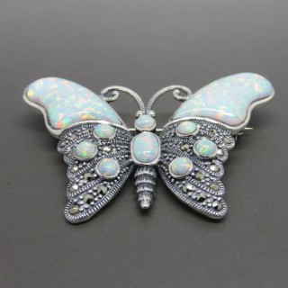 A MARCASITE AND OPAL BROOCH
