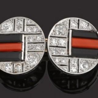 Pair platinum mounted diamond, onyx, coral Art Deco cufflinks.