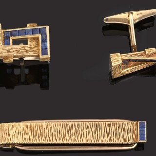 Pair of heavy gold and sapphire cufflinks and tie clip.