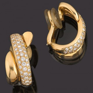 Pair of gold and diamond set hoop earrings.
