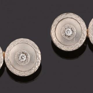 Pair of white gold floral cufflinks, diamond centre.