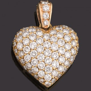 Yellow gold mounted, pave set, brilliant cut diamond heart pendant.
