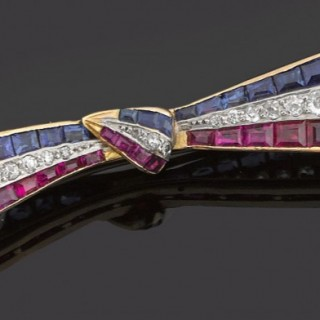 Tied Ribbon Brooch in 18 Karat Gold, Diamonds, Rubies and Sapphires, French circa 1920