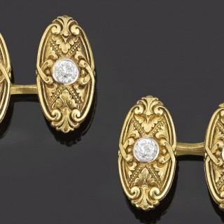 Heavy pair of carved floral gold cufflinks old cut diamond centre