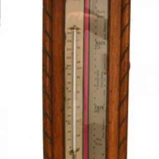 Oak cased Long Range wall barometer by Negretti and Zambra