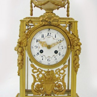 Ormolu Four Glass striking Mantel Clock