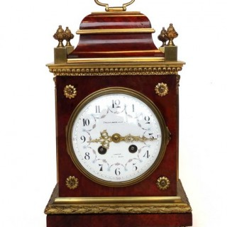 A tortoiseshell and ormolu mounted mantel clock