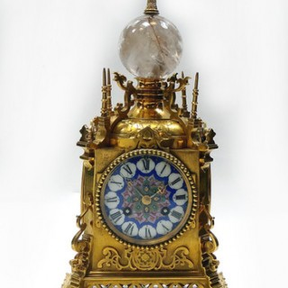 Arabic styled gilt brass and Sevres porcelain mantel clock