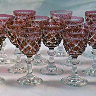 A set of sixteen red over crystal wine glasses Baccarat