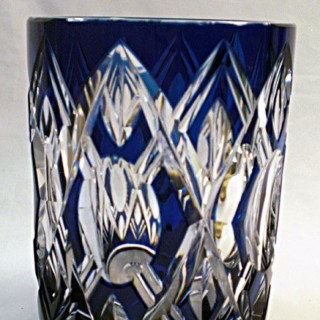 A blue over crystal glass vase