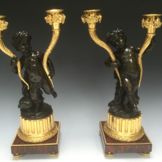 A Pair of Napoleon III Gilt & Patinated Bronze Candelabra After Clodion