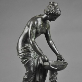 Classical bronze figure of semi-dressed female with a water trough