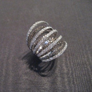A crazy cocktail ring designed with twelve alternating black and white 18 ct gold hoops