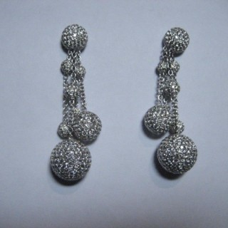 A pair of pave set diamond drop ball earrings by The Gilded Lily