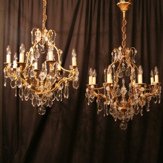 A French Pair Of 8 Light Antique Chandeliers