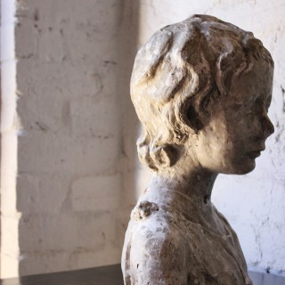 A Decorative 20thC Portrait Studio Plaster Bust of a Young Boy