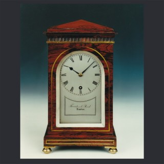 A small Regency rosewood timepiece by THWAITES & REED, London c1830