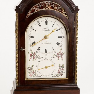 A fine unusual mahogany 8 bell ¼ chiming clock by Tomlin, London C1770 with back winding and turntable base.