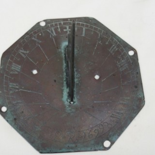 A well patinated early sundial signed E.R X