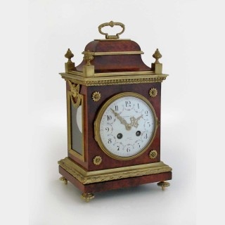 A tortoiseshell and ormolu mounted mantel clock
