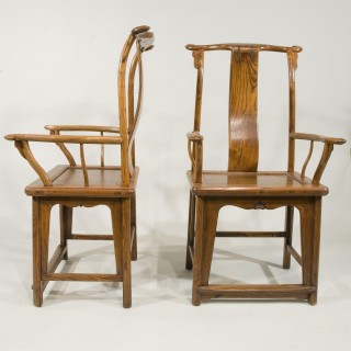 A Pair of Late 18th Century Chinese Elm Yoke Back Armchairs