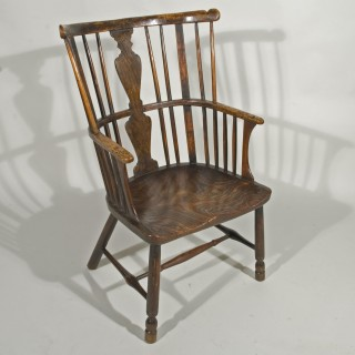 A Late 18th Century Primitive Windsor Shawl Back Chair