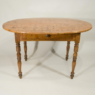 A 19th Century French Ash Cottage Dining Table