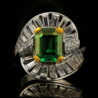 Mellerio emerald and diamond ring, circa 1960.