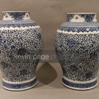 a pair of chinese blue and white temple jars with an intricate floral design