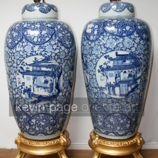 a pair of monumental blue and white kang hsi/yung cheng vases and covers