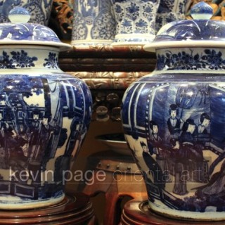 a pair of chinese dark blue and white temple jars and covers
