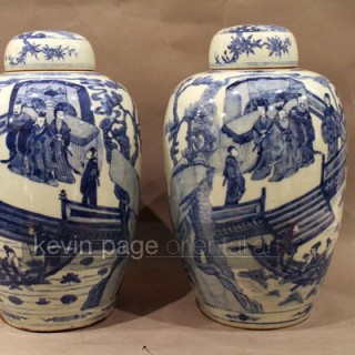 a large pair of chinese blue and white ginger jars decorated with lakeside scenes