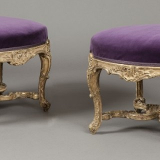 A Pair of Antique Giltwood Footstools in the Early Louis XV Manner