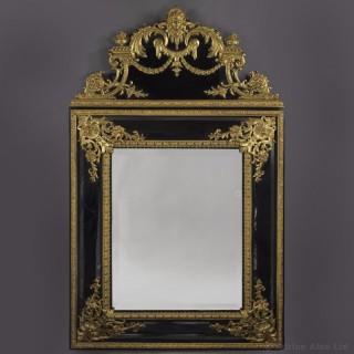 A Rare Régence Style Gilt-Bronze Mounted Ebonised Mirror