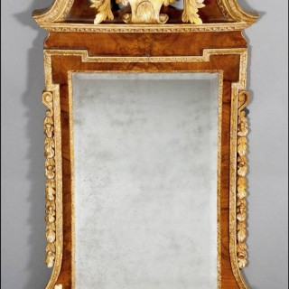 A fine George II walnut veneer and gilded wood PIER MIRROR