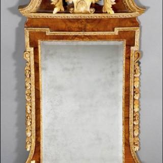 A fine George II walnut veneer and gilded wood PIER MIRROR