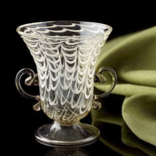 A little glass vessel with ' a penne ' decoration and applied handles