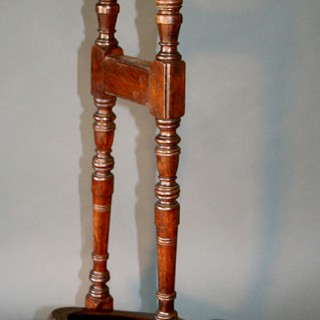 A C19th Oak boot Jack by Peal & Co