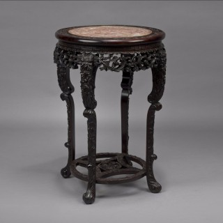 Carved Chinese Hardwood Stand With An Inset Marble Top