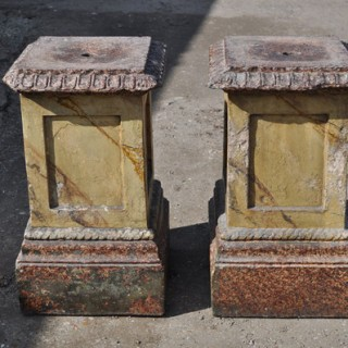 Decorative pair of faux marble stone pedestals
