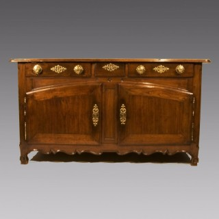 An Early 19th Century French Chestnut Three Drawer Buffet