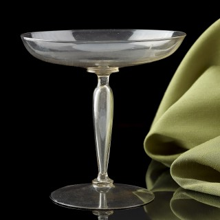 A Venetian wine glass with a low spreading bowl and a ' cigar ' stem