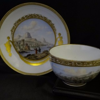 MEISSEN PORCELAIN (worked from 1710)  Meissen Cup and Saucer decorated with Scenic Views (Germany, c. 1775)