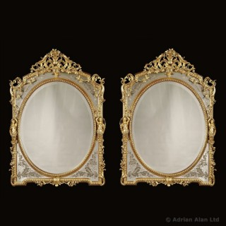 Pair of Napoleon III Verre Eglomisé Carved Giltwood Mirrors