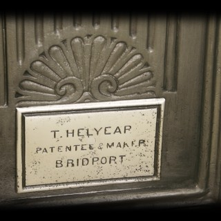 T. Helyear antique cast iron fireplace grate.