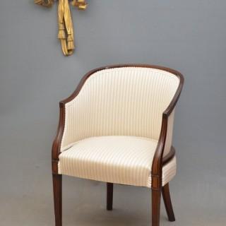 An Edwardian Mahogany Armchair