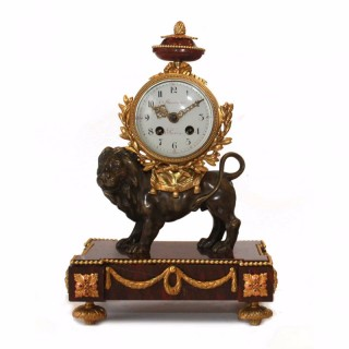 Ormolu, Bronze and red marble Mantel Clock