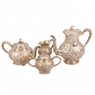 A fine Qing dynasty four piece silver coffee and tea service by K.W